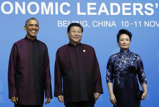 U.S. President Obama poses for photographs with China's President Xi and Xi's wife Peng during the APEC Welcome Banquet at Beijing National Aquatics Center, or the Water Cube, in Beijing